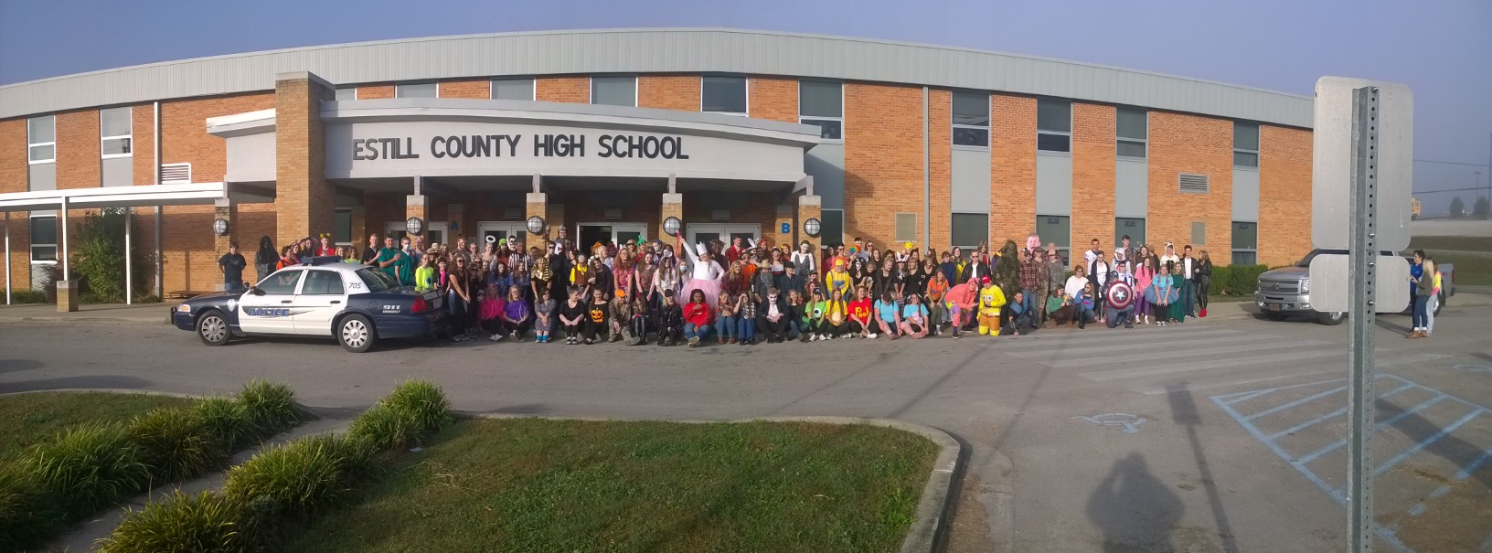 Panoramic picture of high school students in halloween costumes